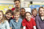 School Children in Class with Teacher